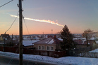 The meteorite contrail is seen over a vilage of Bolshoe Sidelnikovo 50 km of Chelyabinsk. Photo / AP