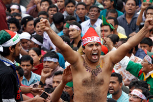 A Bangladeshi activist gets fired up during a protest in the capital, Dhaka. Photo / AP