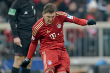 Bastian Schweinsteiger, wearing his regulation red socks, scores for Bayern Munich. Photo / AP