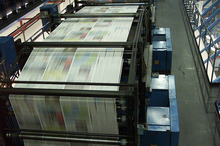 Sections of the New Zealand Herald, which is owned by APN News & Media, being printed in Auckland. Photo / Peter Meecham