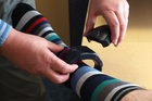 Low security prisoners will now be tracked when travelling between prisons and their workplaces by fitted GPS ankle bracelets. Photo / Supplied