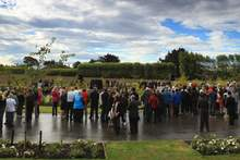 Christchurch residents attend the dedication and unveiling of a memorial at Avonhead Cemetery last year. Photo / Greg Bowker
