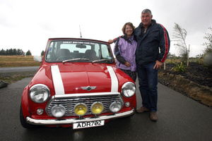 Sandy and Dave Ryan, participants of the Great British Car Rally, with their Mini Cooper. Photo / Wairarapa Times-Age