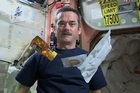 """A popular Canadian astronaut orbiting the earth 16 times a day is beaming his """"Space Kitchen"""" cooking show back down to his fans. Credit: CSA/NASA"""