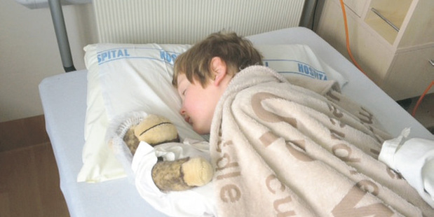 Brodie Hunter with his toy monkey Dr Fitz who is now reported as a 'missing person'. Photo / Supplied