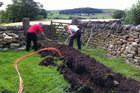 Lancashire locals digging trenches for high speed broadband as part of the b4rn project. Photo / supplied