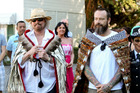 Barry Gibb and his son Stephen after they were adorned with korowai (cloaks) before a Maori welcome. Photo / Glenn Taylor