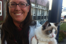 Heidy Kikillus with Pancho Villa the cat outside the cat meeting. Photo / APNZ
