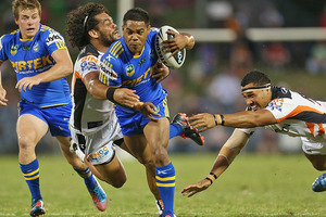 Chris Sandow of the Eels makes a break during the NRL trial match against the Wests Tigers. Photo / Getty Images
