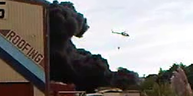 Loading A helicopter battles a blaze at a scrap metal yard in Wanganui. Photo / Supplied