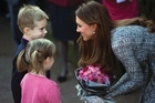 "The Duchess of Cambridge, who is expected to give birth to her and Prince William's first child in July, visited an addiction charity in London on Tuesday - making no reference to being described as a ""shop window mannequin"" with a ""plastic smile"" by British novelist Hilary Mantel."