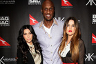 Khloe Kardashian, right, with her husband Lamar Odom and sister Kim. Photo/AP