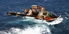 What is left of the stricken ship Rena on the Astrolabe Reef off the coast of Tauranga. Photo / Bay of Plenty Times