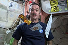 Chris Hadfield shows viewers how to make a peanut butter and honey sandwich in space.Photo / YouTube