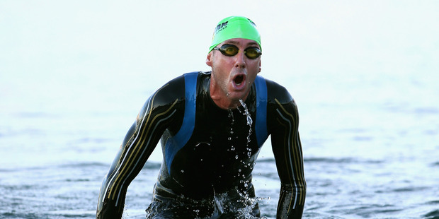 Bervan Docherty exits the water after the swim leg. Photo / Getty Images