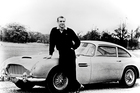 Sean Connery in the 1964 film Goldfinger with the Aston Martin DB5. Photo / Supplied