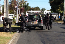 The Armed Offenders Squad attends a stand-off in Glenview, Hamilton. Photo / Christine Cornege