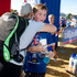 Ben Jeffery, 13, from Mt Eden gets a hug from his mum Lissa Gilliver during the Weet-Bix Kids TRYathlon held at St Heliers in Auckland. Photo / Dean Purcell