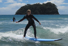 Rachel Grunwell tries a surfing lesson at Mount Maunganui. Photo / Supplied