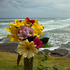 A flower tribute sits on a fence post as a memorial for Muriwai local Adam Strange, at Muriwai Beach. Photo / Brett Phibbs