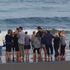 Friends and family of Adam Strange at a healing ceremony at Muriwai Beach. Muriwai man Adam Strange, 46, was killed by a shark while swimming on Wednesday. Photo / Bret Phibbs