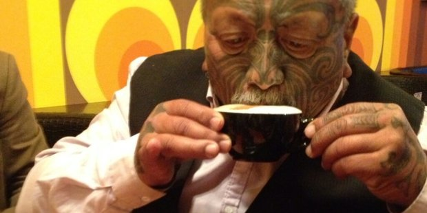Tame Iti enjoys a cappuccino on his first day after being released from prison. Photo / Twitter