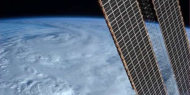 Cyclone Rusty hovers over Australia, as seen from the International Space Station. Photo / Chris Hadfield/Twitter
