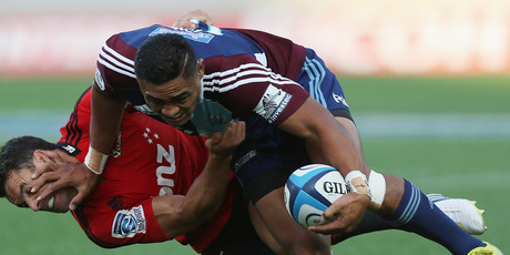 Francis Saili of the Blues fends off Daniel Carter of the Crusaders. Photo / Getty Images.