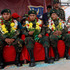 Bolivian soldiers Alex Choque, center, Augusto Cardenas, right, and Jose Luis Fernandez wear flowers around their necks as they are honored after being freed from custody in Chile. Photo / AP