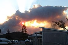 The Dome Valley fire at sunset as viewed from the Whangateau campground. Photo / Nigel Carlton/Supplied