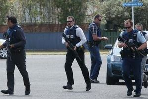 Armed police on Arataki streets. Photo / Joel Ford