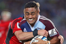 Francis Saili attempts to escape Dan Carter during Friday's comprehensive Blues win over the Crusaders. Photo / Getty Images