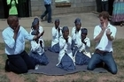 Britain's Prince Harry visited his charity projects in Lesotho on Wednesday, finding time to perform traditional dance moves with children during his return visit to the southern African kingdom.