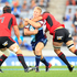 Blues Tom McCartney is tackled by Crusaders in their Super Rugby match at Eden Park Auckland. Photo / Richard Robinson.