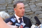 Prime Minister John Key has denied that the Solid Energy crisis and Telecom job cuts are a black mark against the Government's handling of the economy.