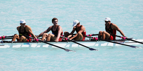 Nathan Cohen, Nathan Flannery, Fergus Fauvel and Hayden Cohen celebrate their victory in the quadruple sculls. Photo / Getty Images