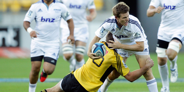 Chris Noakes encounters Beauden Barrett during the Blues' opening Super match, against the Hurricanes on Saturday. Photo / Getty Images