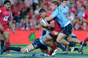 Reds Chris Feauaui-Sautia is wrapped up by the Waratahs defence.Photo / Getty Images