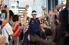 Mike Allsop finishes his final marathon at Wynyard Quarter in Auckland, yesterday. Photo / Brett Phibbs