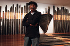 Ralph Hotere with his installation Black Phoenix. Photo / Otago Daily Times