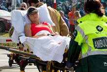 The injured jogger is taken to hospital.  Photo / Brett Phibbs