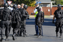 Armed police cordon off the Glenview unit and surrounding streets. Photo / Christine Cornege