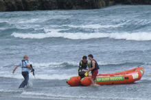 Police fired up to 12 shots at a killer shark in a bid to retrieve the body of a swimmer that had been attacked off Muriwai Beach. Photo / Tracy Howarth