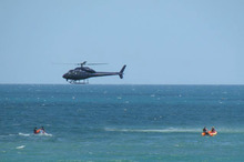Police prepare to shoot a shark after the fatal attack on a swimmer at Muriwai Beach. Photo / Tracy Howarth