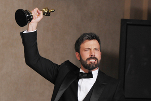 Ben Affleck poses with his award for best picture for Argo. Photo / AP