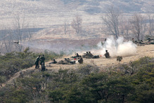 A Korean People's Army artillery unit participate in a live fire drill while North Korean leader Kim Jong Un, unseen, inspects the unit at an undisclosed location, in North Korea.  Photo / AP