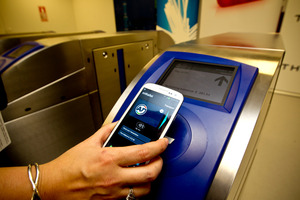 Demonstrating the new mobile wallet on replica gates at Thales test lab in Auckland. Photo / NZH