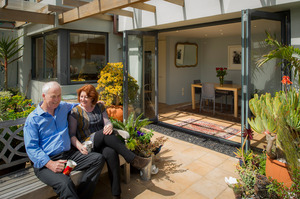 Maggie Barry and Grant Kerr at their Pt Chevalier home, which sold below its valuation. Photo / APN