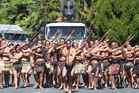 Maori warriors accompany a 26-tonne Maori carving on its way to the Rotorua stadium. Photo / APN