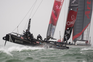 Emirates Team New Zealand in pre race manouvers with Artemis Racing Red in 2012.  Photo / Chris Cameron